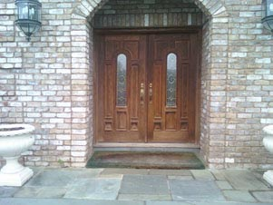 mahogany doors with arcghed glass